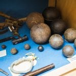 Cannon balls found near Lecompton, Kansas.  At the Territorial Capital Museum.