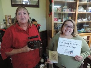 Volunteer Deb Powell, left, and Project Curator Kristie Dobbins, right, work on the collection at the Territorial Capital Museum. Kristie Dobbins' position is funded by a grant through Freedom's Frontier National Heritage Area.