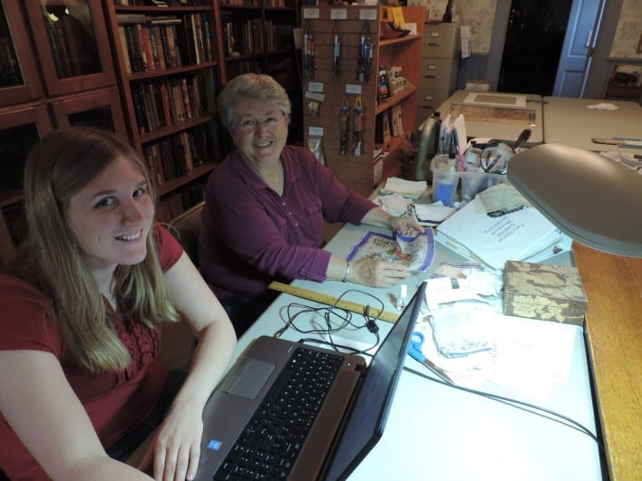 Carolyn Stauffer and Rebecca work on a women's handkerchief collection.