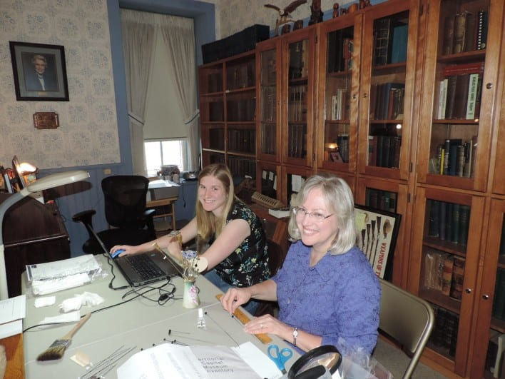 Gina (on right) inventoried our hatpin collection with Rebecca.