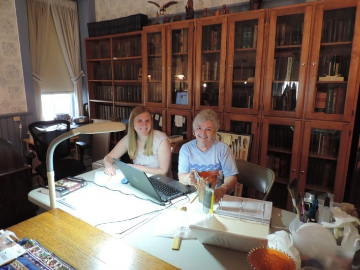 Elsie Middleton and Rebecca Dickman work on some beautiful carnival glass.