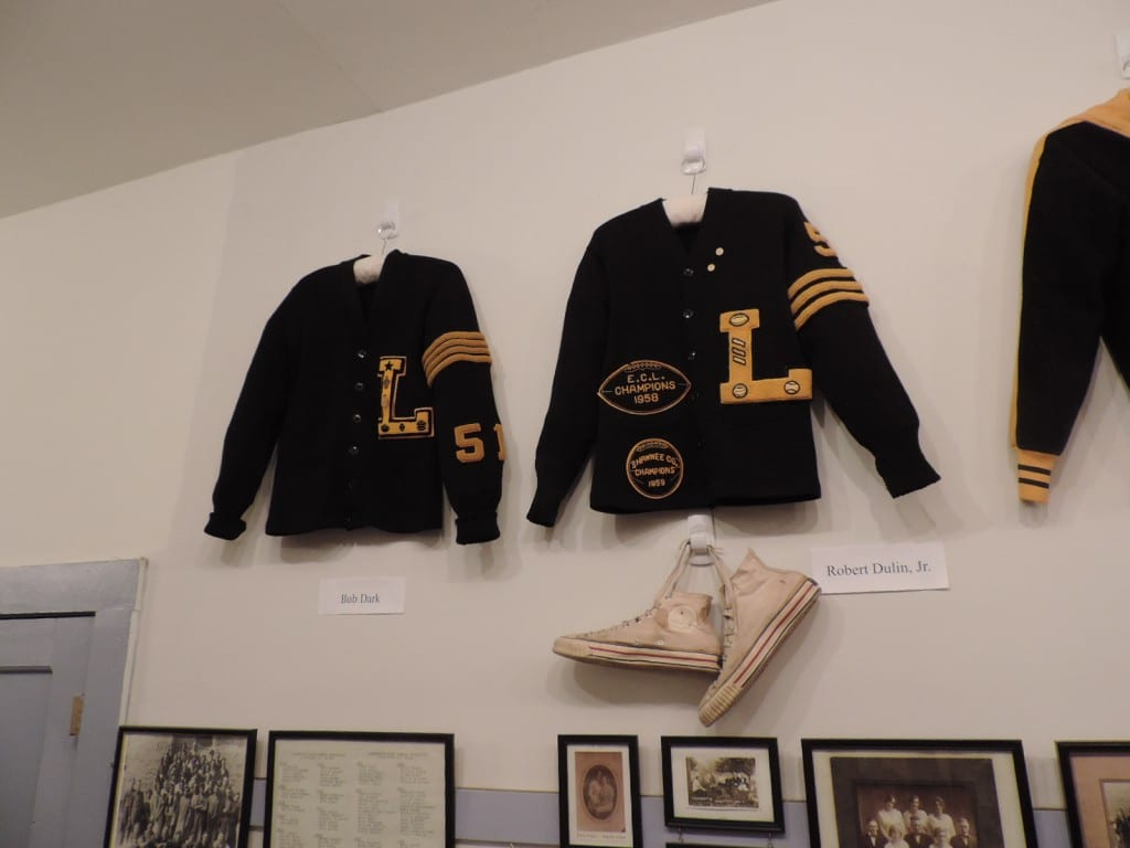 Letter sweaters of Bob Dark, left, and Robert Dulin, Jr., right. Plus Dulin's high school basketball sneakers!