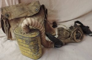 """Clarence had to use his gas mask while in the trenches and """"going over the top."""""""